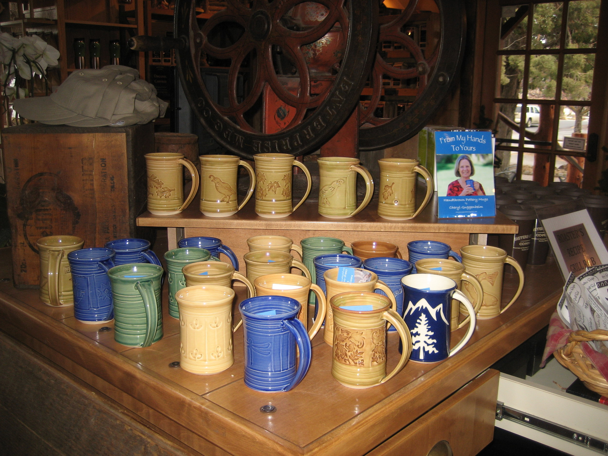 Mugs on display inside Sisters Coffee shop in Sisters, Oregon.
