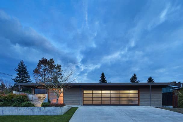 Accentuate The Given - The existing roofline defines the house. Make the horizontal beautiful. Give presence to the entrance. A substantial, wide pivot door creates a unique welcome to the home.