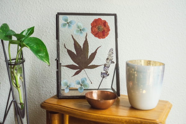 dried flowers in metal and glass picture frame at Foraged Home
