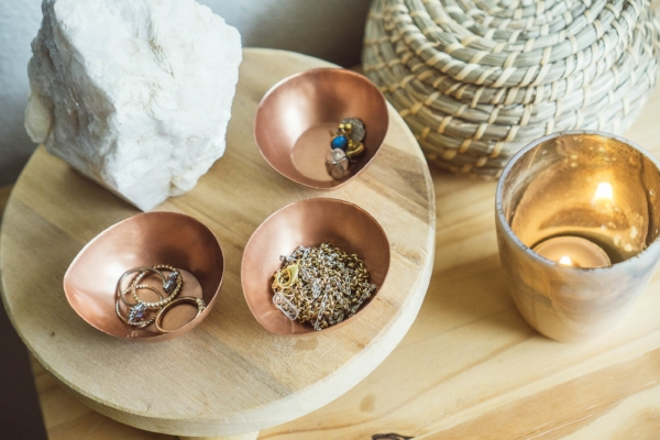 small copper metal bowls for ring and jewelry dish in boho style bedroom at Foraged Home