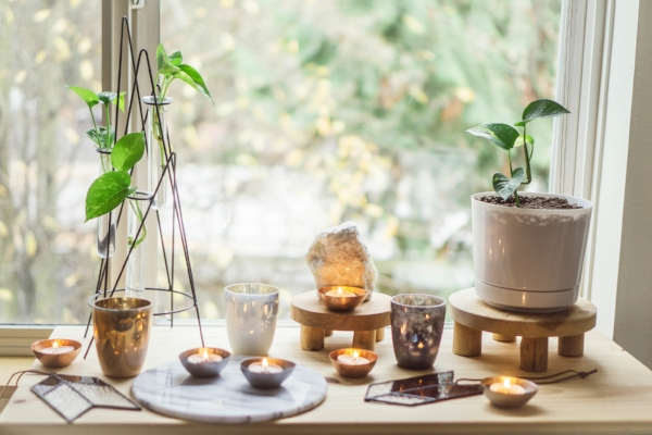 Bohemian style bedroom with votives, tealights and plants at Foraged Home