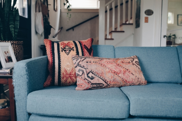 Cozy vintage home in Portland, OR with peach and red kilim pillows via Foraged Home