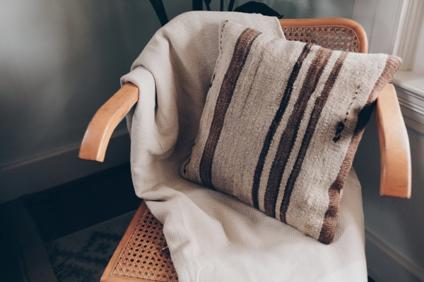 Neutral striped kilim pillow in bohemian home via Foraged Home