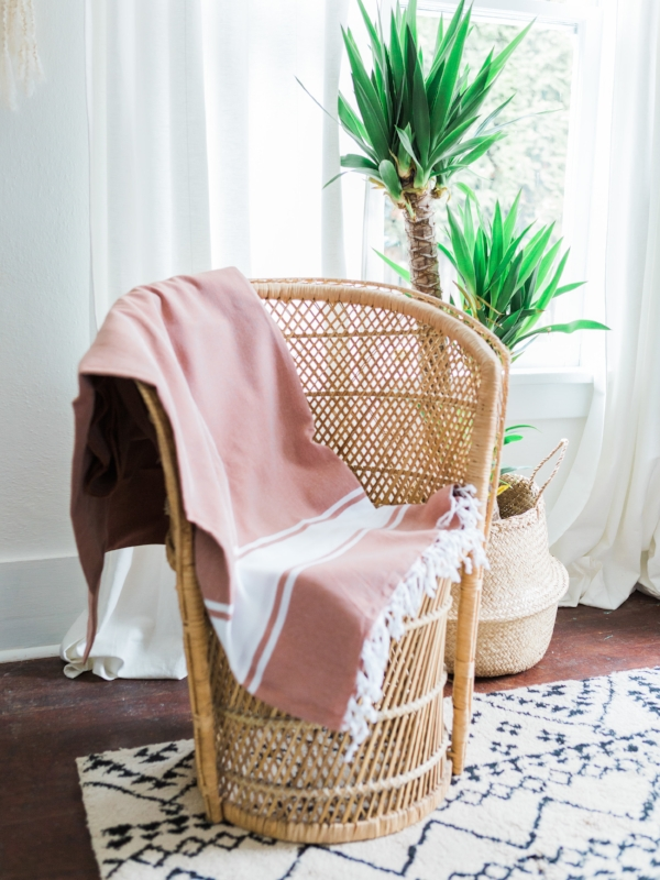 rattan chair with turkish linen blanket by Foragedhome.com