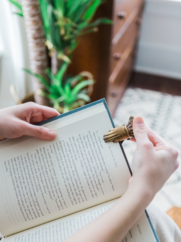 Brass vintage hand clip used as a bookmark for readers from Foraged Home