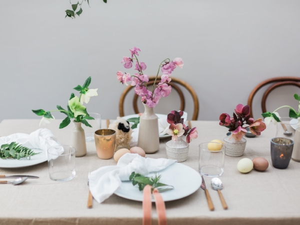 Simple and clean Easter brunch centerpiece with fresh flowers and Easter eggs