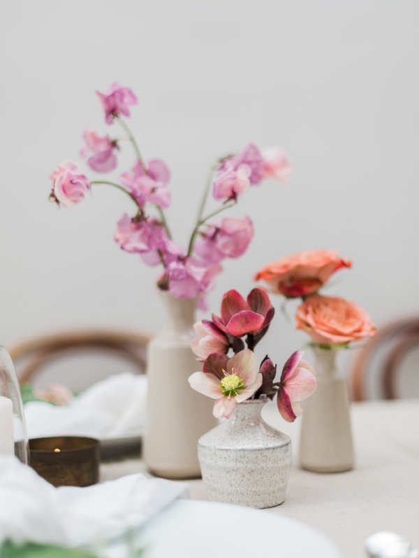 Colorful spring flowers in grey bud vase for centerpiece by Foraged Home