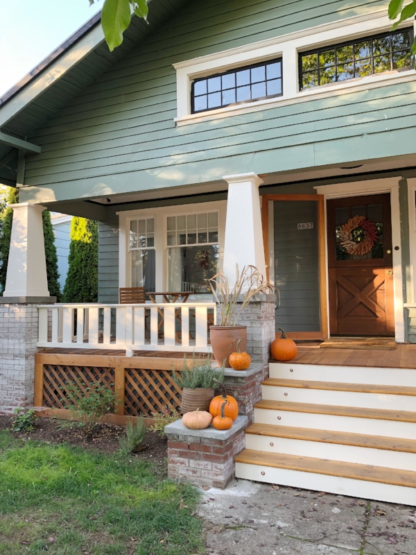 Outdoor fall/autumn decorations in craftsman/bungalow home in Portland featuring pumpkins by Foraged Home