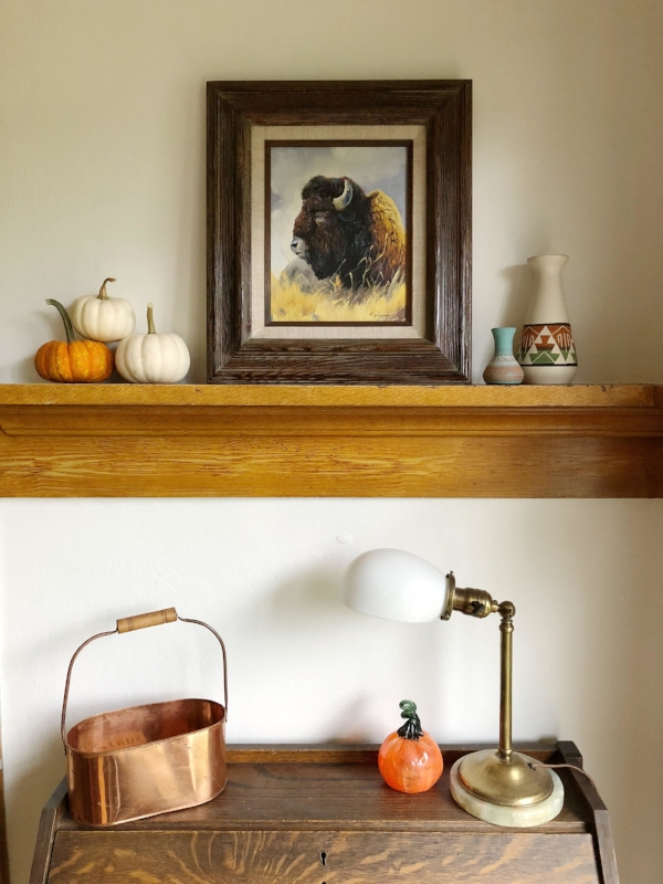 Small desk nook in craftsman/bungalow home with antique desk and fall decorations with pumpkins from Foraged Home
