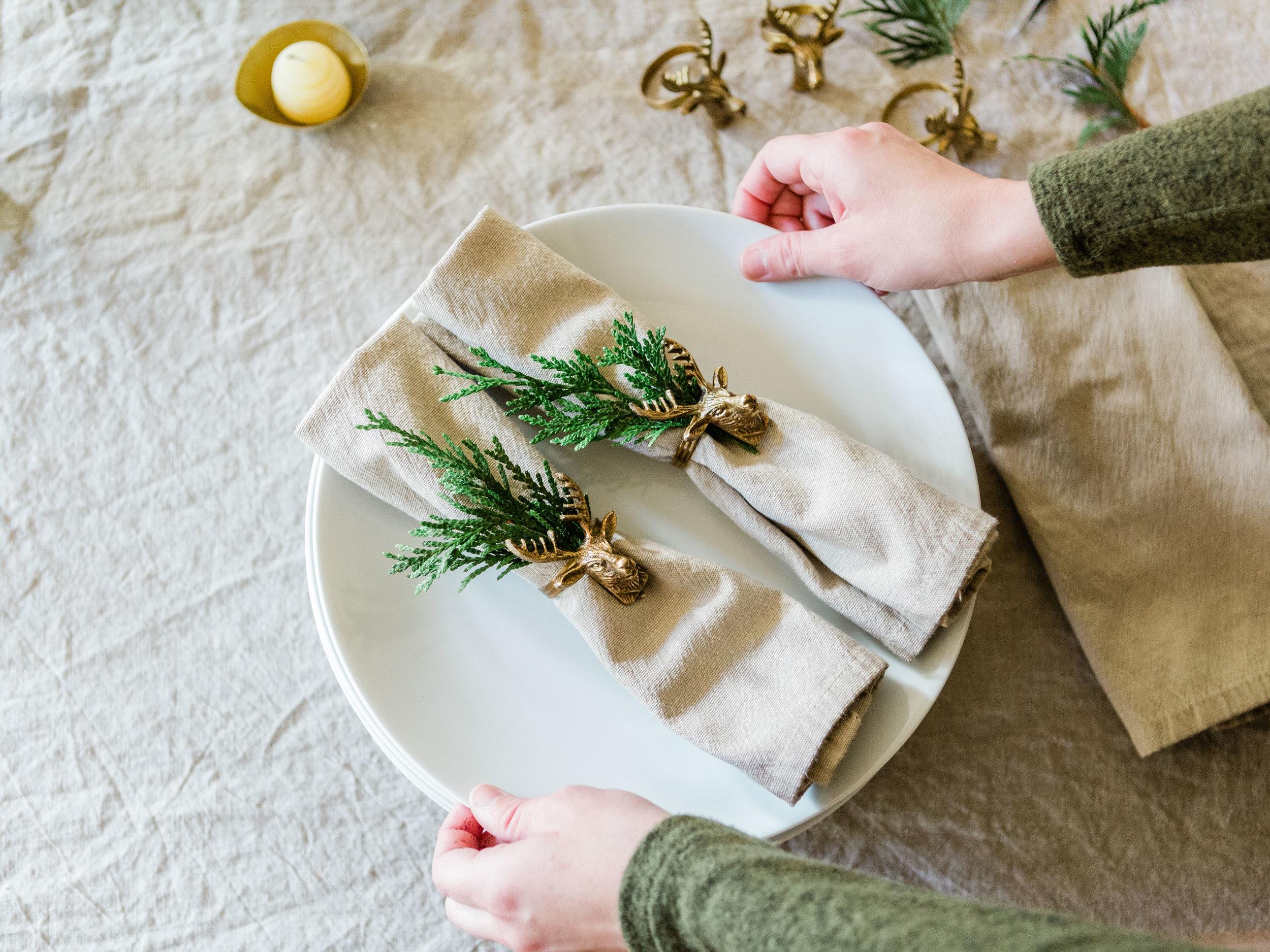 Gold deer napkin rings    Beeswax tealights    Metal bowls