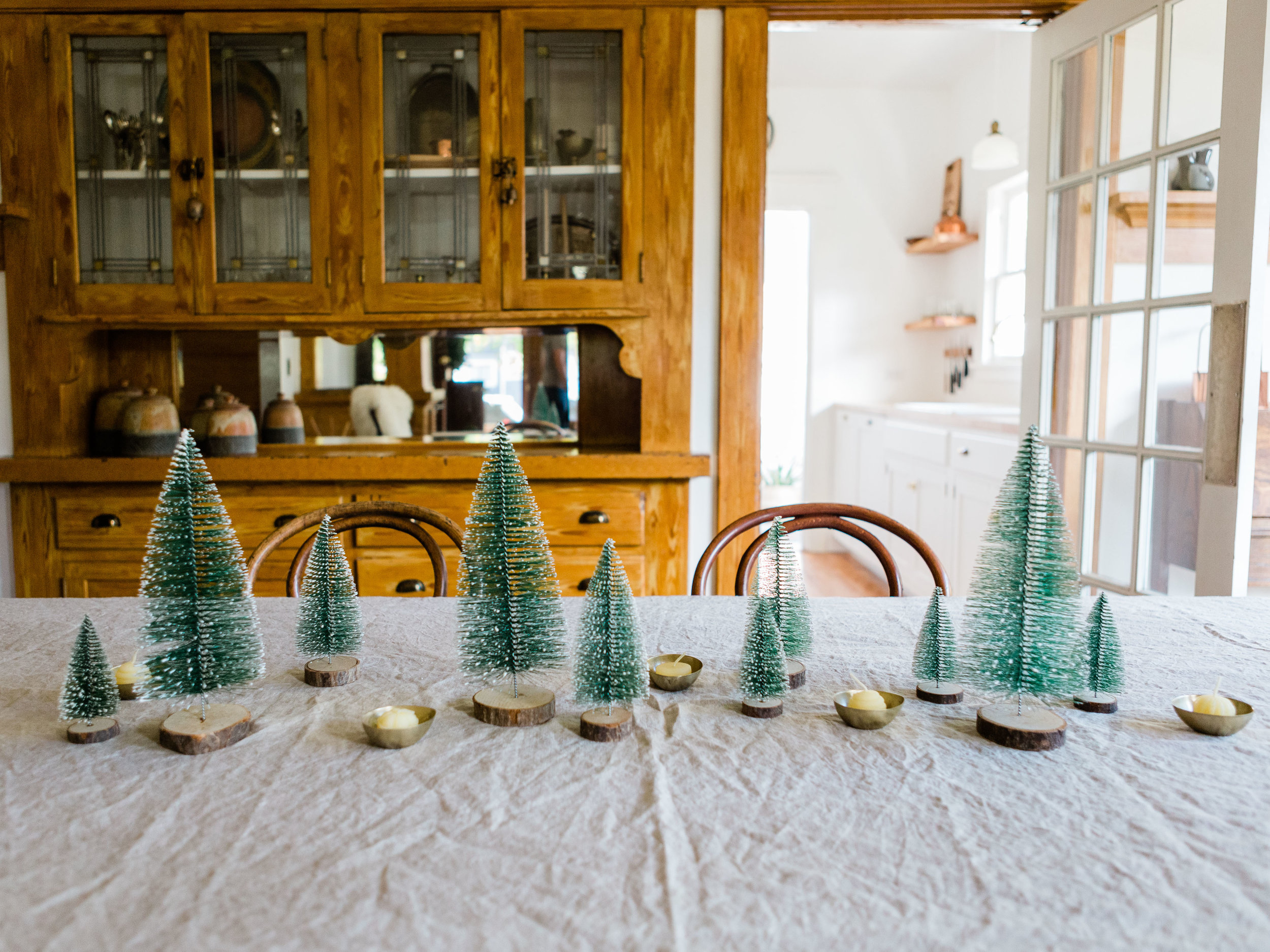 Bottle brush trees as holiday centerpiece from Foragedhome.com