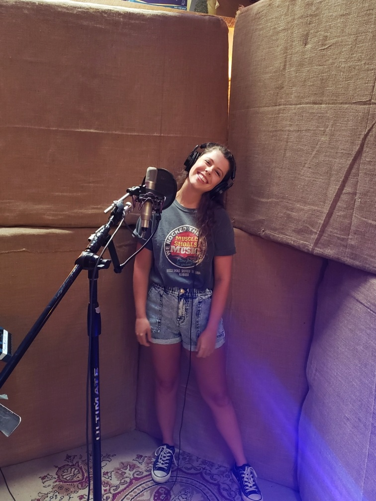 Singing at Dark Horse on Justin's songs. He took this while he was coaching me through a harmony haha.