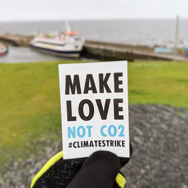 Amazing to meet some young people today at a #climatestrike in Scotland. We love their slogan! #makelovenotco2