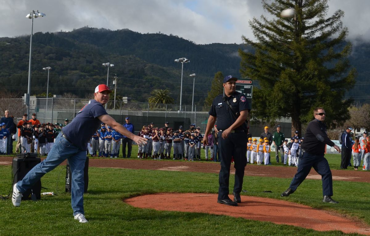 Representatives from local fire departments were invited to throw the ceremonial first pitch at St. Helena Little League's Opening Day on Saturday at Crane Park. Pictured, from left, are Deer Park's Cory Worthy, St. Helena's Mark Macias and CalFire's Tim Erskine.