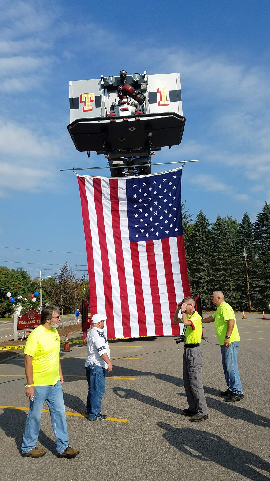 American Flag being displayed by the Franklin Fire Department @ the MA Elks Motorcycle Run.