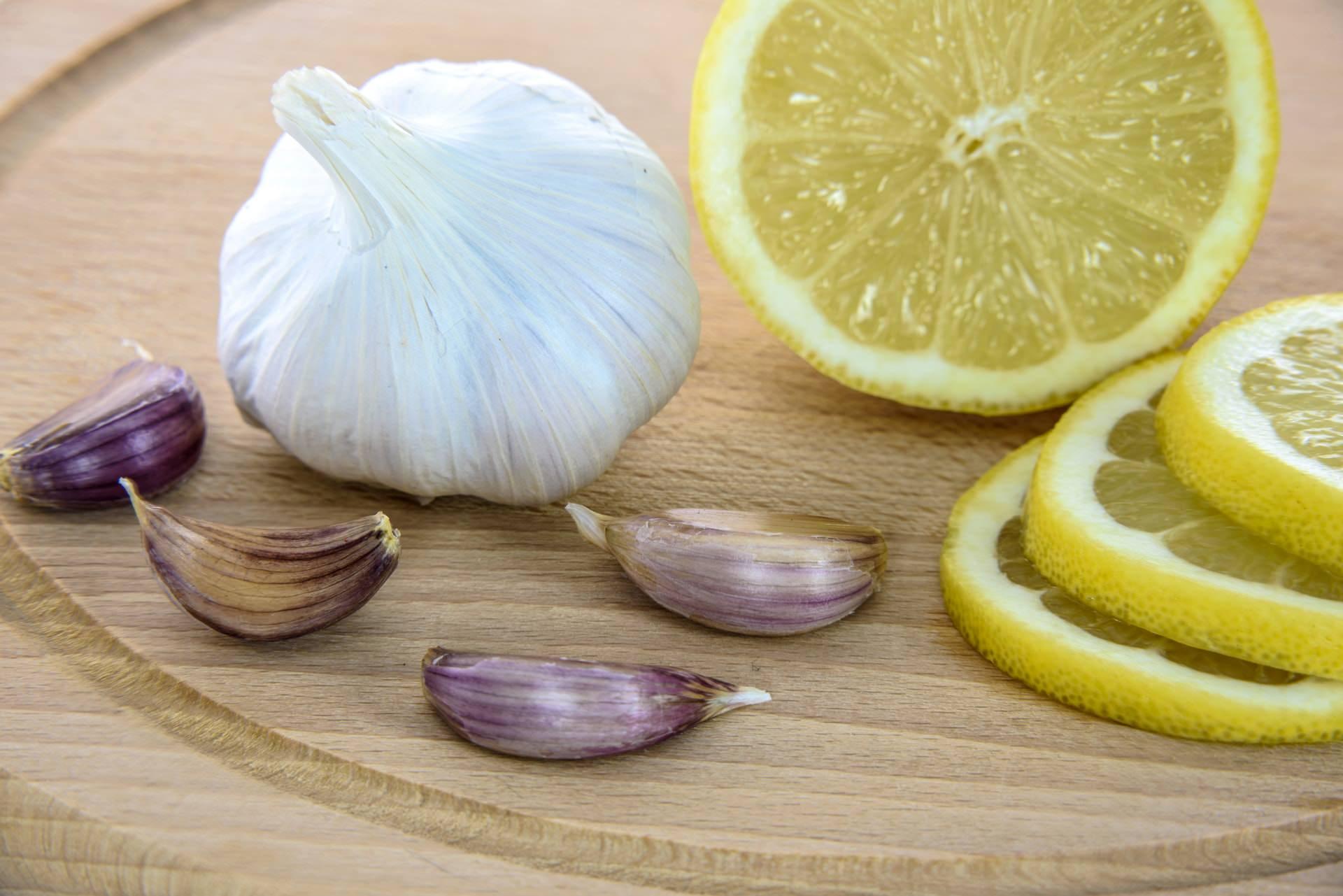 peeled garlic lemon healthy cutting board stock