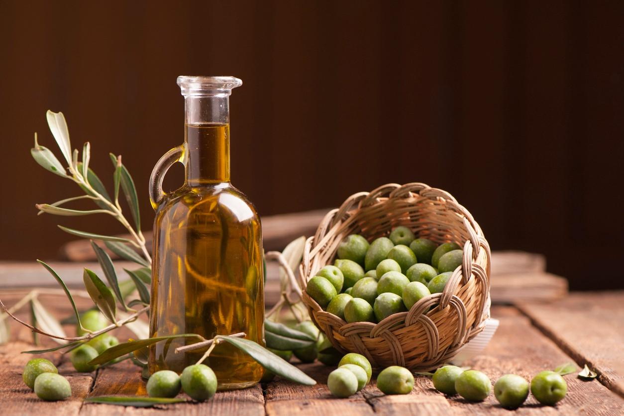 extra virgin olive oil bottle basket of olives
