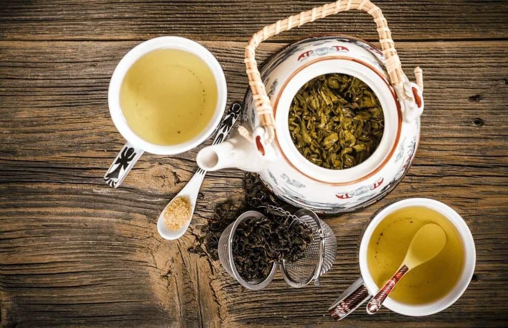 tea pot with white and green tea