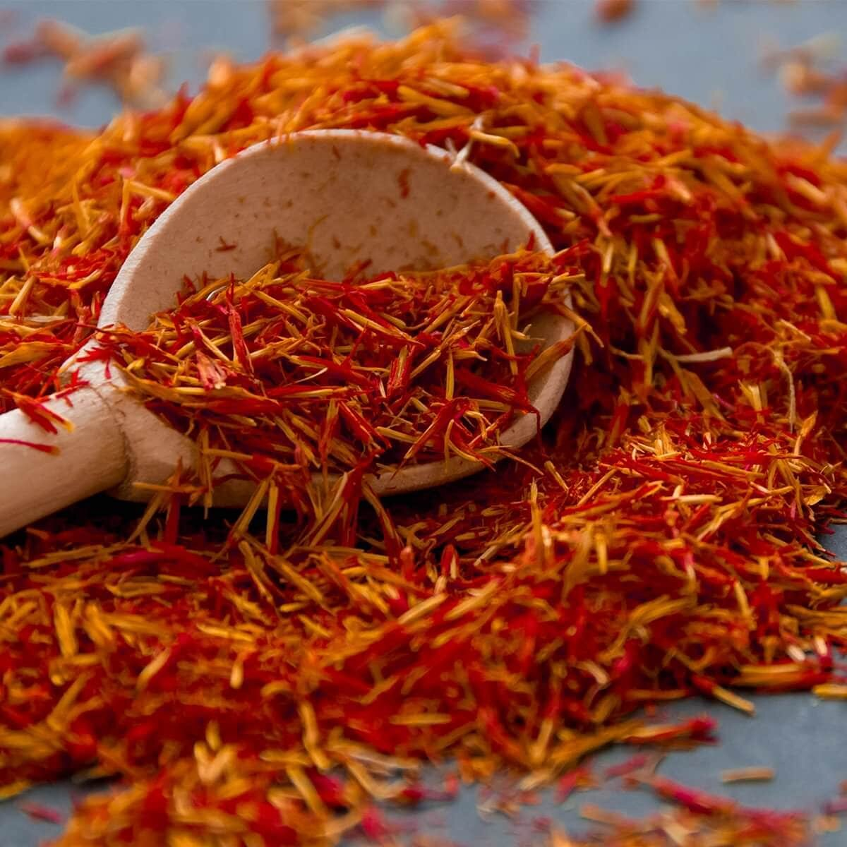 wooden spoon filled with saffron