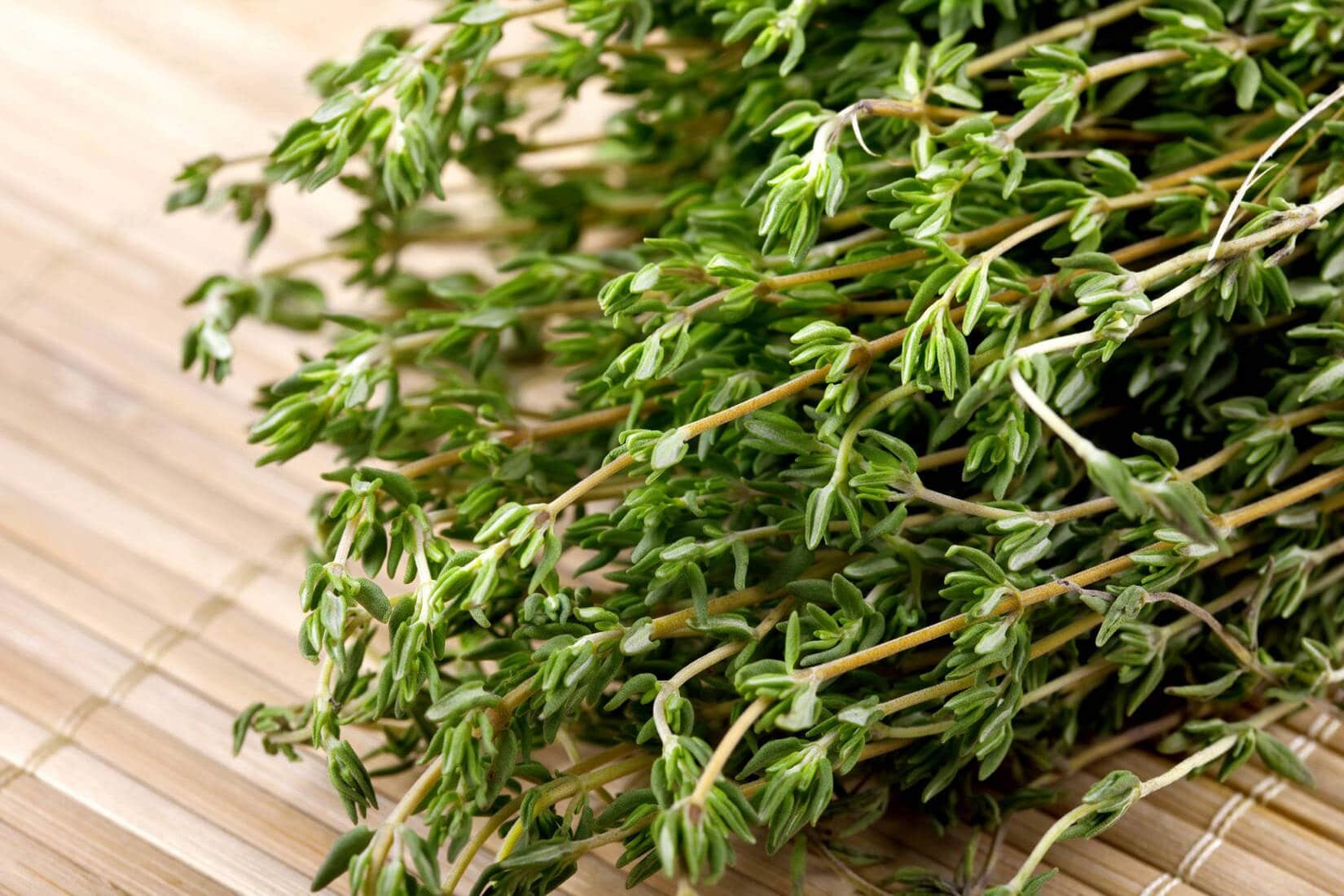 thyme herbs on a cutting board