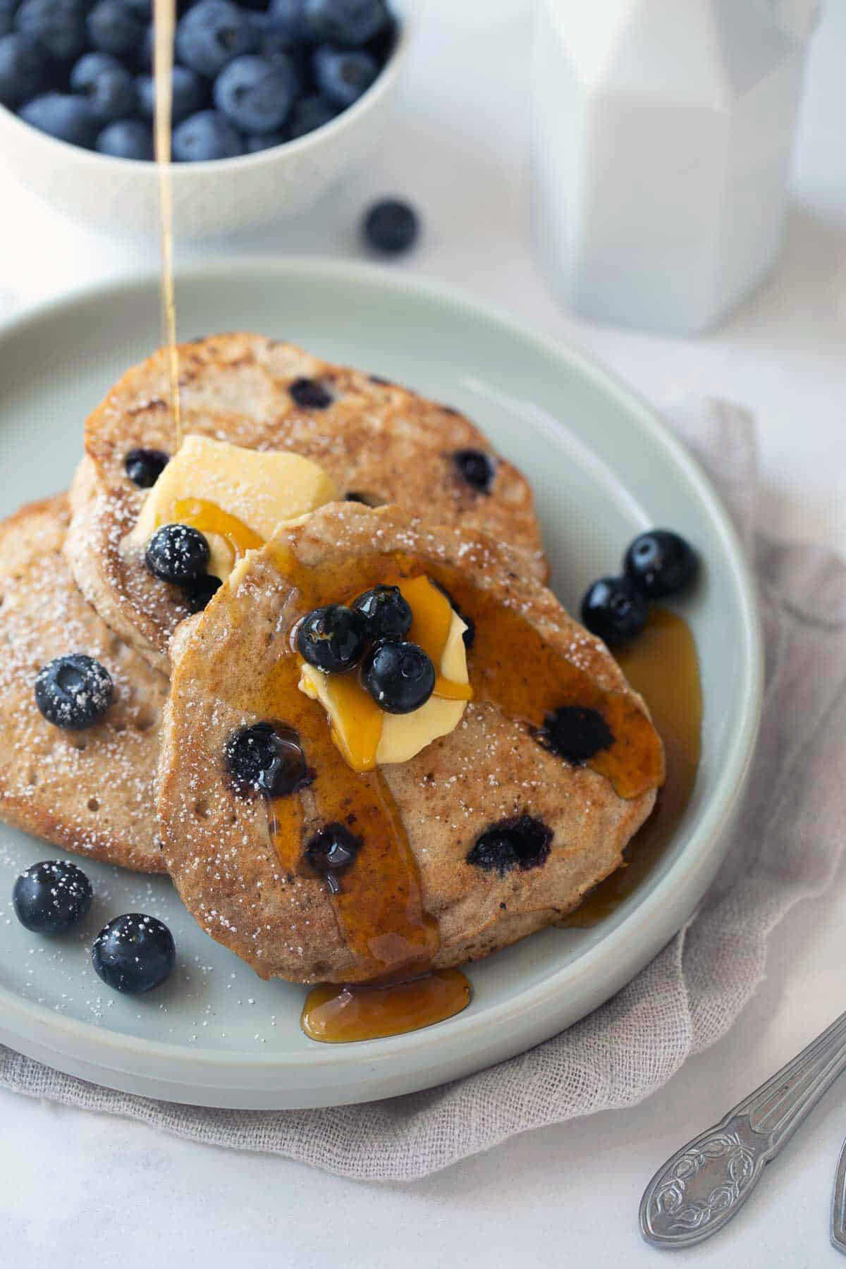 buckwheat pancakes with maple syrup and blueberries