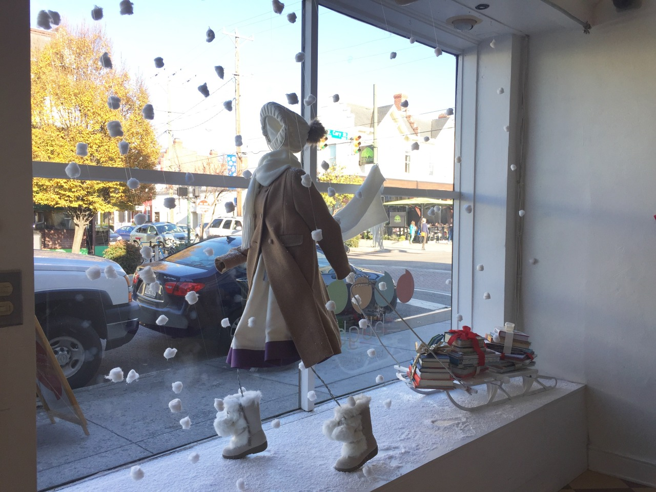 """Amazing store window!  From listener Julia:""""I found my favorite store window! There is a smallbookshop near me in Richmond called BBGB Tales for Kids and they have the most adorable window. The display was designed by Scout Designs which is a local design company. It's so wintery and lovely."""""""