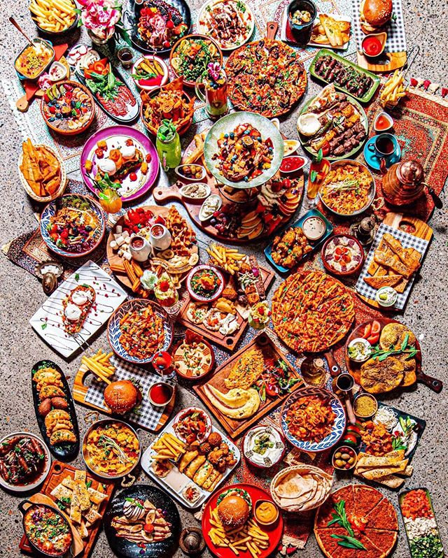 """""""Haters say it's photoshopped"""" 😉 @themiddlefeastau — Well, it would be easier to Photoshop a spread like this, but where's the fun in that? 😂 One of the best parts about my job is getting to photograph fun and engaging food menus like The Middle Feast. Locals will know its tasty eats as they sit in a surrounding from the Aladdin movie, I now know it as the time I tried to see how long I could stretch a cheesy knafeh 😁 how high is too high? That's a rhetorical question surely! — #georgescameras #sydneyfood #sydneyfoodie #sydneyeats #sydneyrestaurants #foodfluffer #flatlay #flatlayforever #middleeasternfood #middleeastern #sydneyrestaurant #sydneydining #foodphotographyandstyling #foodpornography #foodphotography #foodporn #handsinframe #middleeastfood #devour #onthetable #breakfastinsydney #brunching #sydneybrunch #sydneyfoodporn #sydneyfoodguide #sydneyfoodbloggers #sydneyfoodblog #melbournefoodie #melbourneeats"""