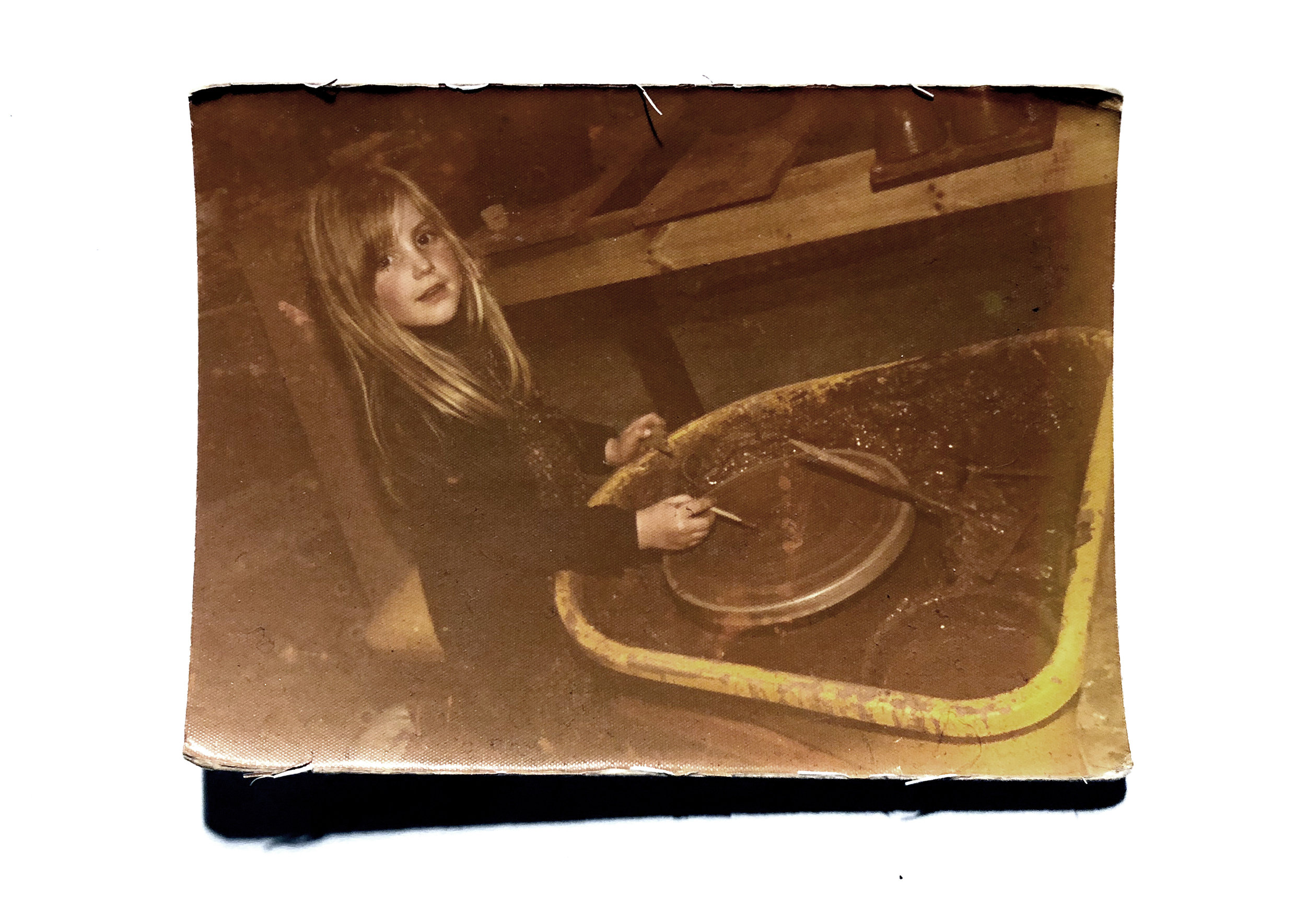 Claire at the wheel in Oxnam in the Scottish Borders aged 6