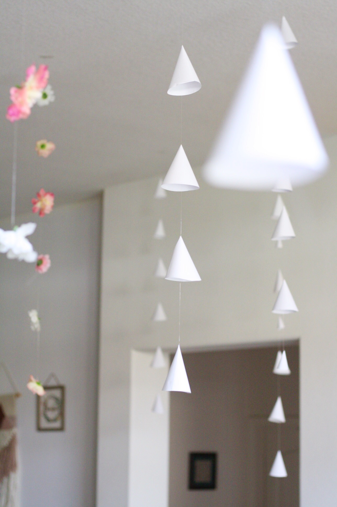 Paper Cone & Flower Hanging Garlands - Add this beautiful and easy to make decor to your next event without breaking the bank!