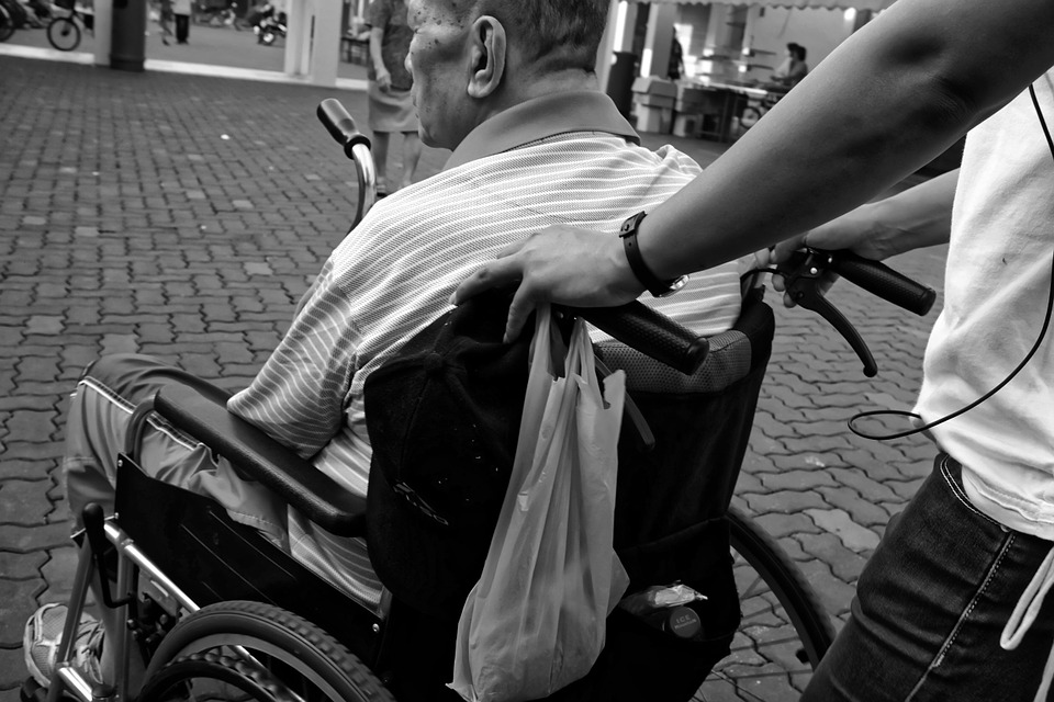 Man-Pushed-Carer-Wheelchair-Elderly-952183.jpg