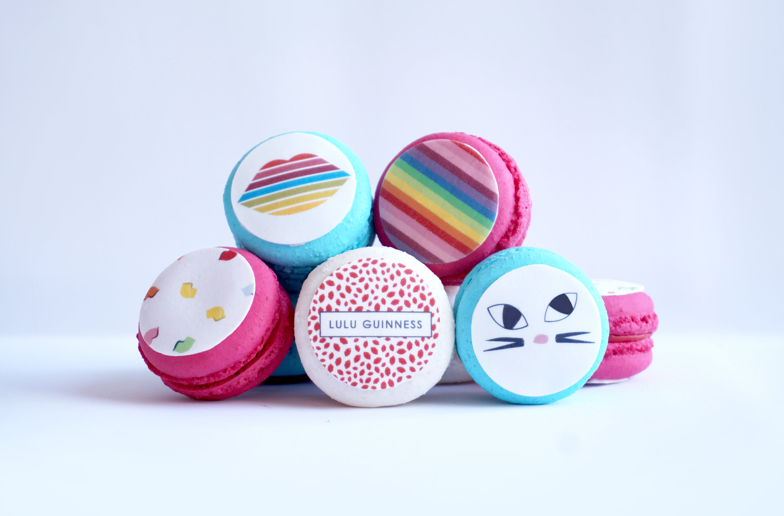 LIMITED EDITION MACARONS - A selection of Lulu's latest designs top our brightly coloured macarons, making the cutest edible statement pieces! Filled with our bestselling flavours, these are available in vanilla, rose and raspberry.