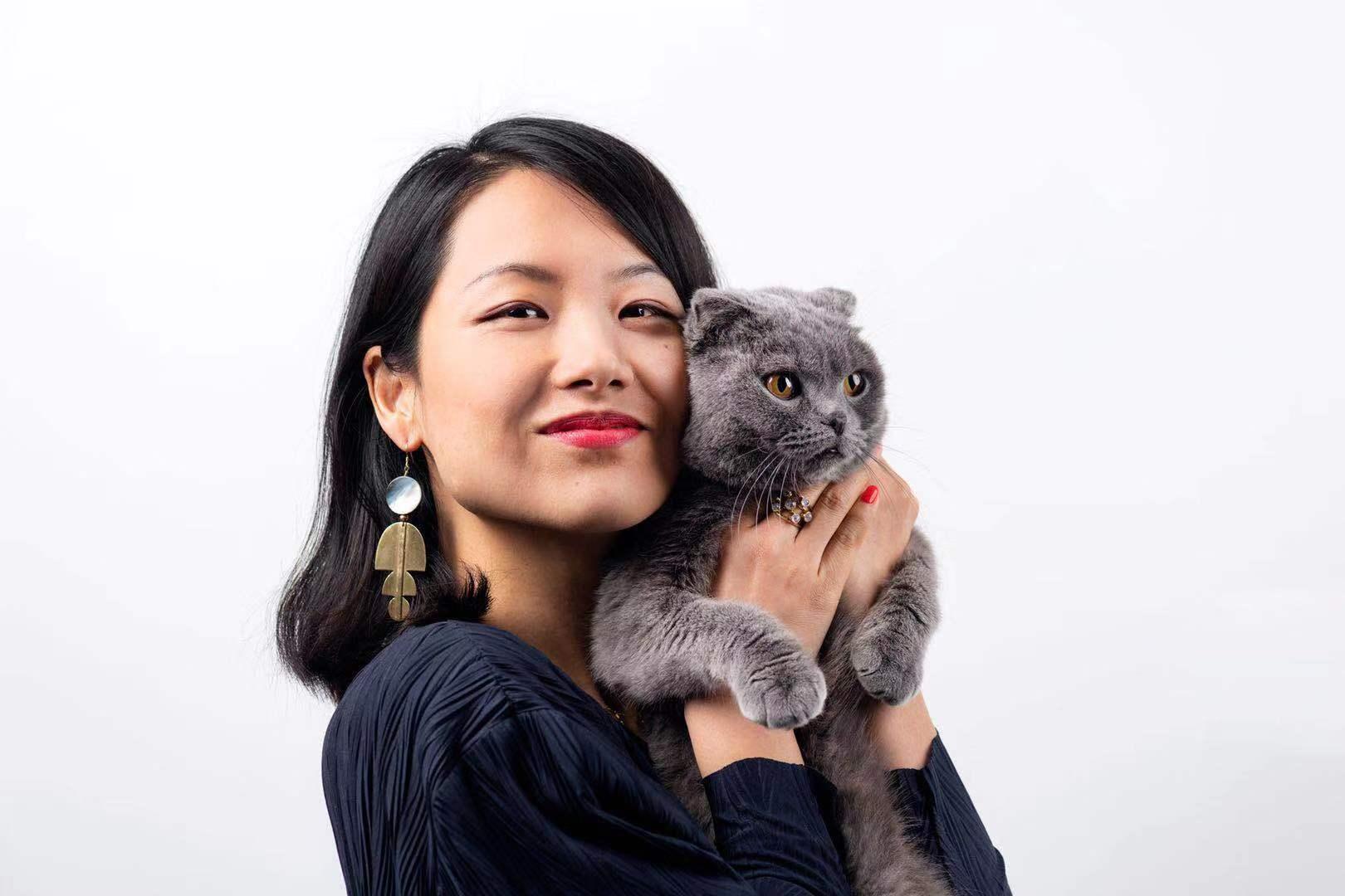 Yiyi wearing    Mantra Earring