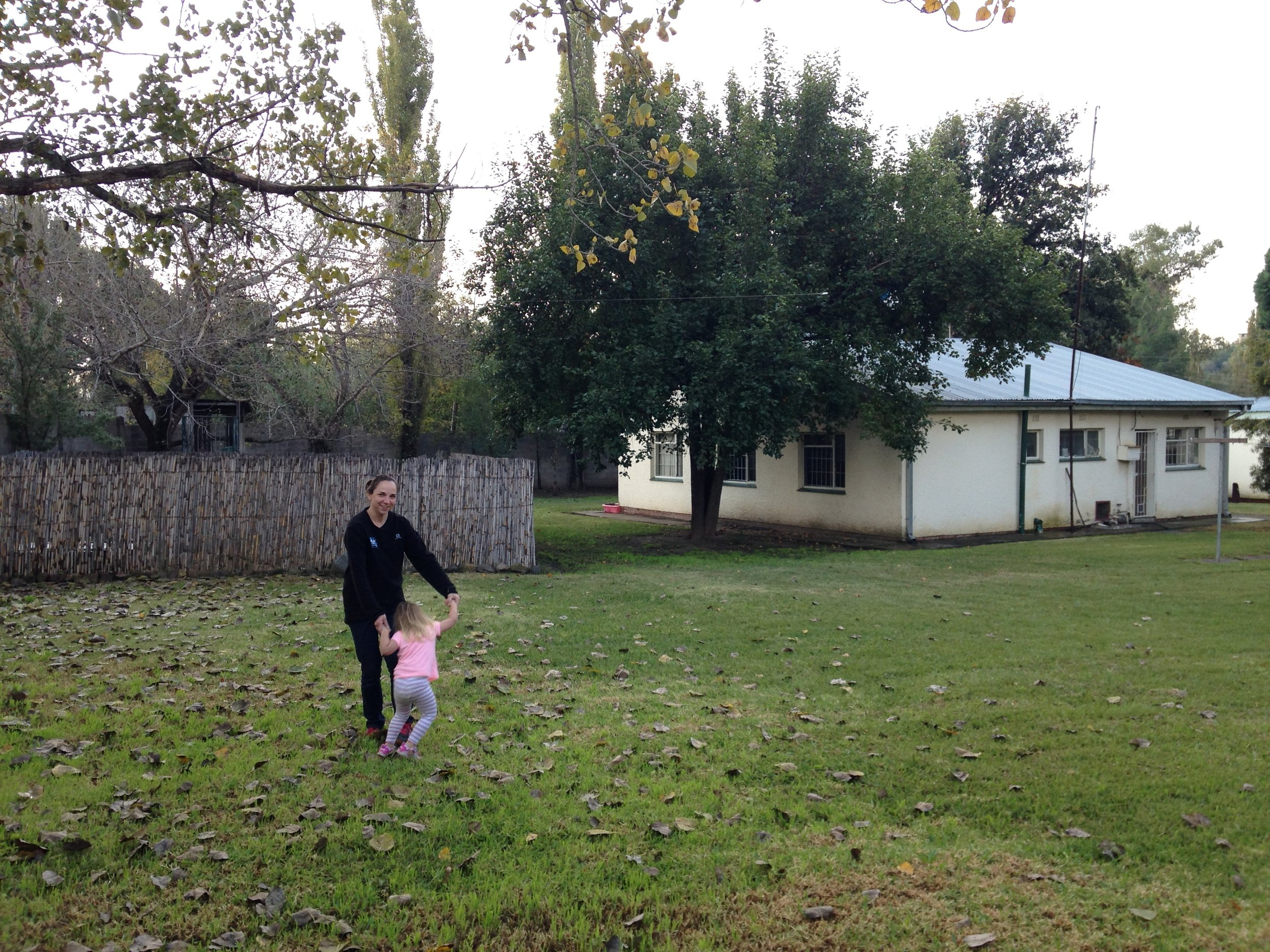 Emily and Jane in the yard of our Maseru house