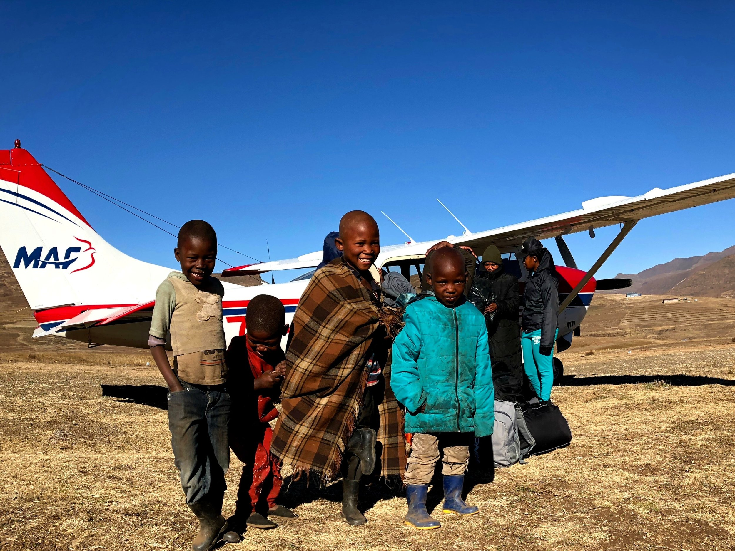 People are always excited to see the planes arrive to their village. One place in particular, I always notice a group of kids standing in the same spot when I taxi past for take-off. They are always waving and smiling. On one flight in June I stopped the plane near their hut (the huts are about 10 meters away from the runway) to offload. They were very excited to get closer and see what the plane looked like inside!