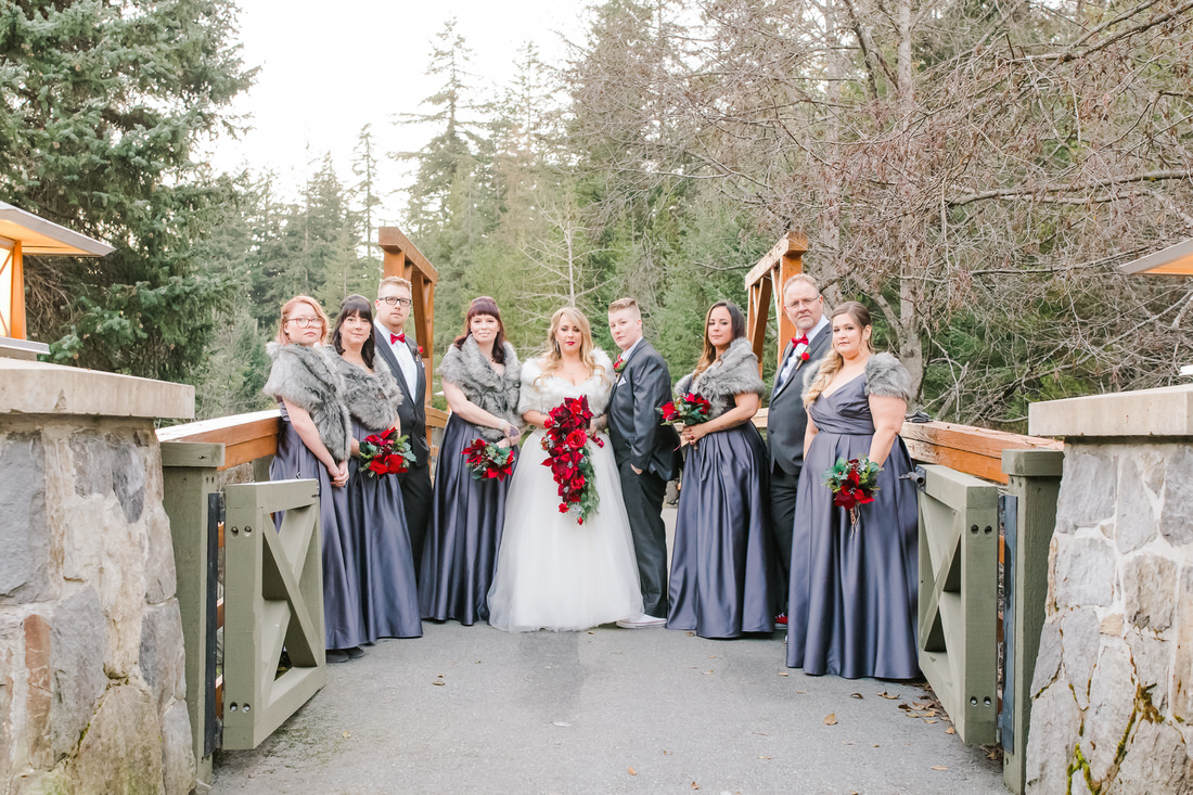 A Wedding Family Portrait Checklist For Your Photographer bridal party group standing on bridge
