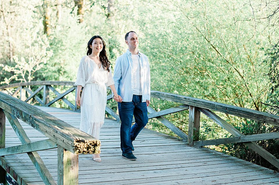 Birmingham Wedding Photographer Aaron & Julia's Urban Garden Engagement Session couple walking over a bridge