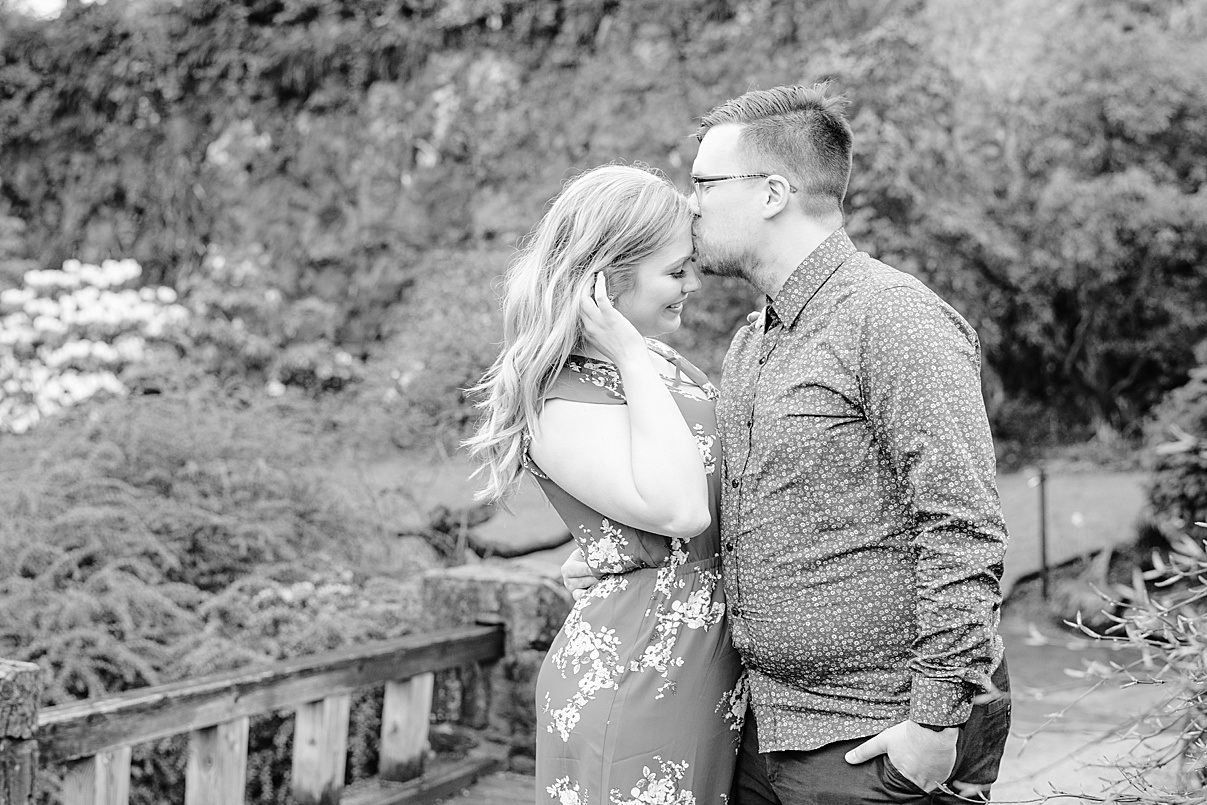 Wedding Photographer Birmingham Cherry Blossom Engagement Photo Session couple kissing forehead black and white image