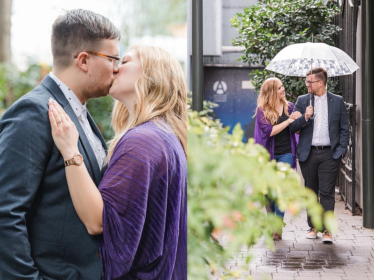 Birmingham Wedding Photographer couple kissing and walking while holding umbrella