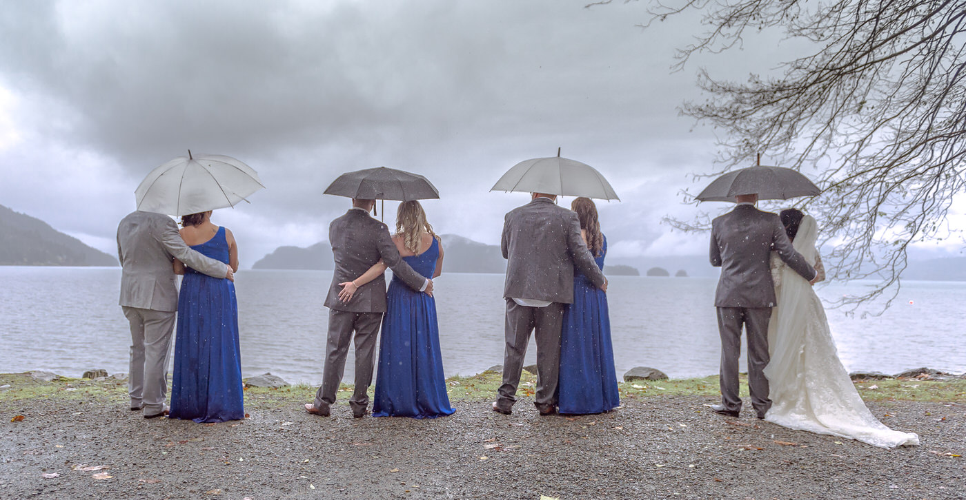 What Happens if it Rains On Your Wedding Day bridal party standing in the rain for thir wedding photography