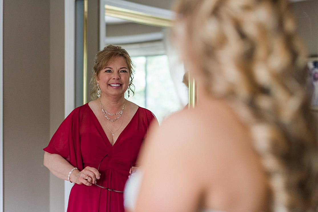 brides mum sees her in wedding dress bridesmaids getting ready taken by west midlands wedding photographer Lisa Lander
