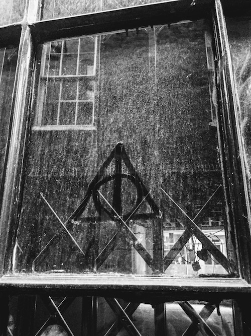 "A mysterious deathly hallows symbol found down ""Knockturn Alley""."