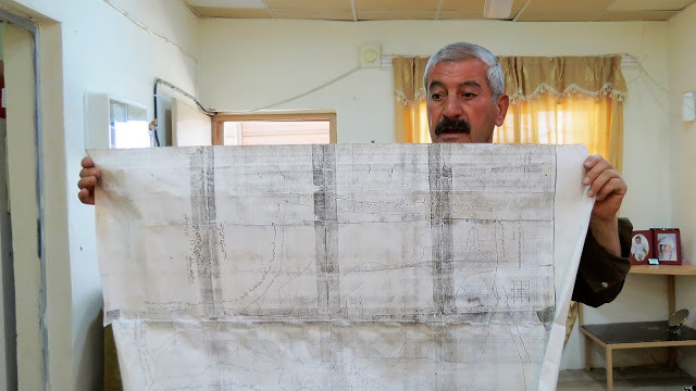 Kak Najib showing the historical map of his village's land to the CPTer. Photo by: Julie Brown.