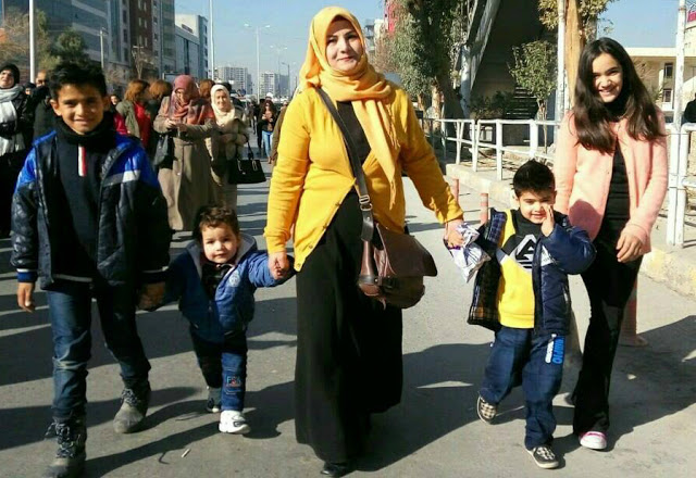 Sazgar and her children marching in the city of Sulaimani. Photo by: CPTers