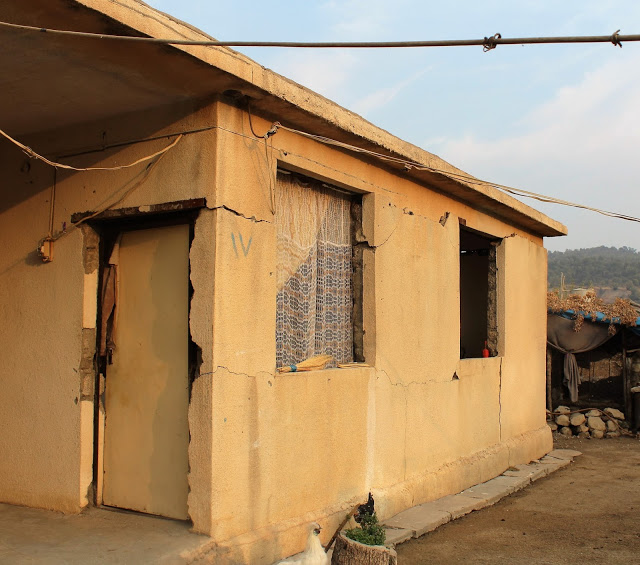 One of many damaged houses in Muruke. Photo by: Kasia Protz