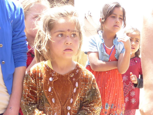 Children reminded of recent shelling. Photo by: Julie Brown.
