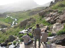"""Halgurd and two CPT delegates   sitting at the head of the   White Spring (""""Kani Spi"""" in Kurdish.)"""