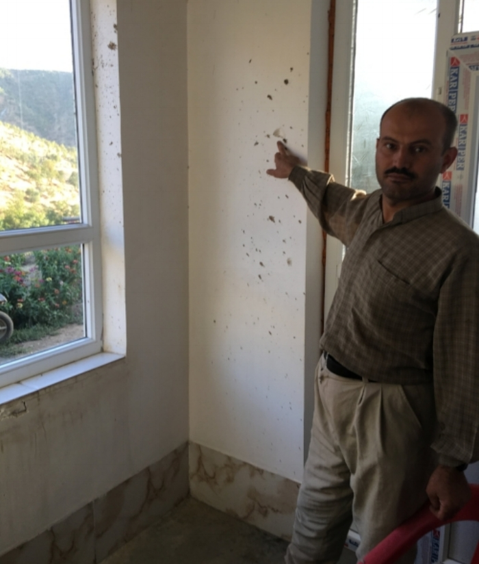 A villager showing the CPTers the damages that were caused to his house due to the Iranian bombardments.