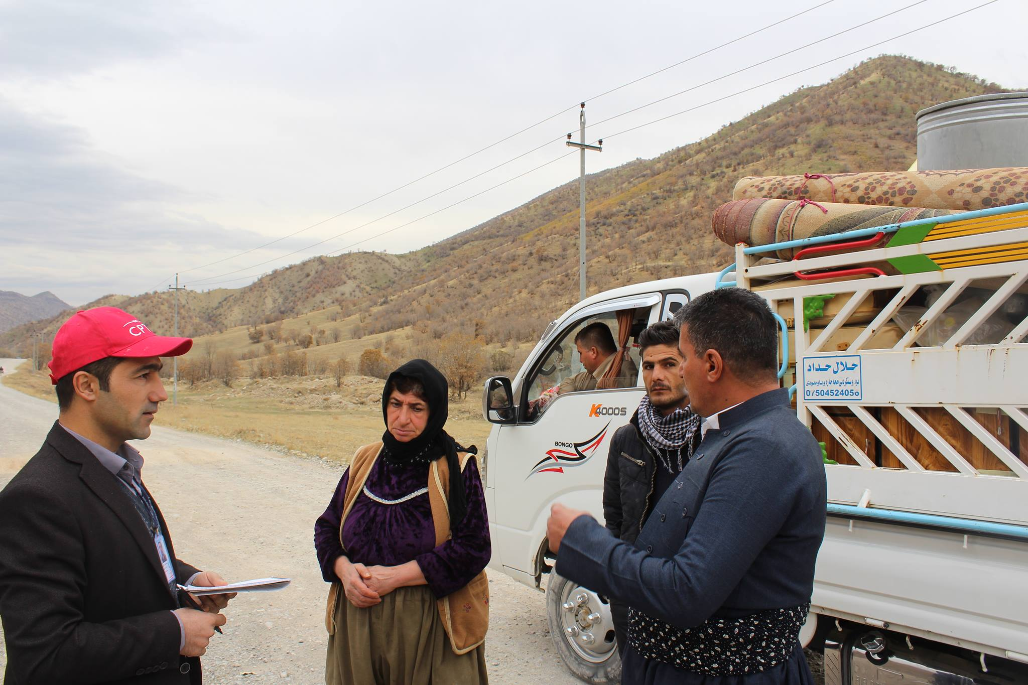 CPT meets with villagers fleeing Gallalla Village.