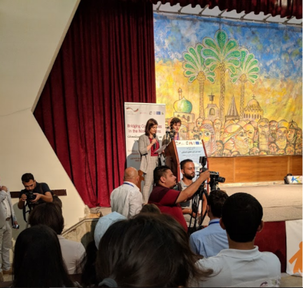 Martina Pagnatti, UPP president, welcoming participants to Nineveh Peace Conference. Photo: Weldon Nisly