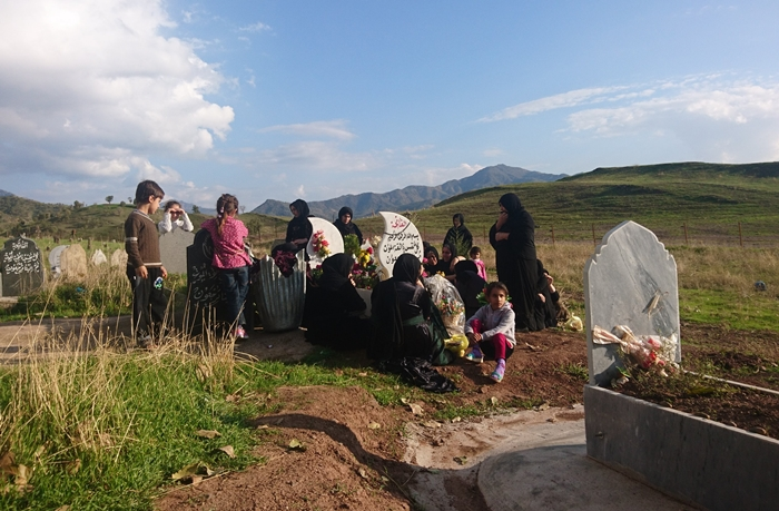 Family of Himdad Darwesh visiting their son's grave on one year anniversary of his death.